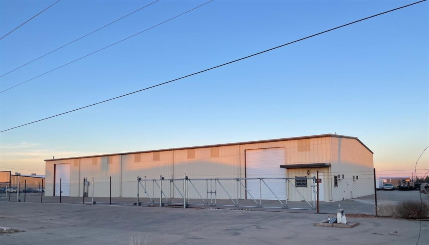 Great 9,300sf warehouse/shop with 2 office spaces and bathroom. 18f side walls, 5 overhead doors, and  2 bays with their own bathroom.  The yard is concrete,  cyclone fence with 2 new electric gates. Outside of city limits, septic and new well. Located on Hwy 87 (I-27). Car lift and air compressor can stay with good offer.