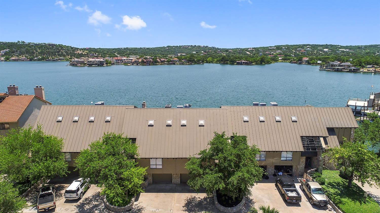 Open water updated townhome in the heart of Horseshoe Bay. Located within walking distance to the Yacht Club and the resort tower. With 4 bedrooms and 4 full bathrooms this townhome is about 2,506 square feet. Every floor of this unit has outdoor space, so you can enjoy the lake from every level! The property has sweeping open water views from nearly every room! The lower deck allows you to jump right into the lake or spend your time fishing. Hydraulic boat lift already installed as well as a jet ski lift. You won't want to miss out on this one! 301 Island Drive Unit B