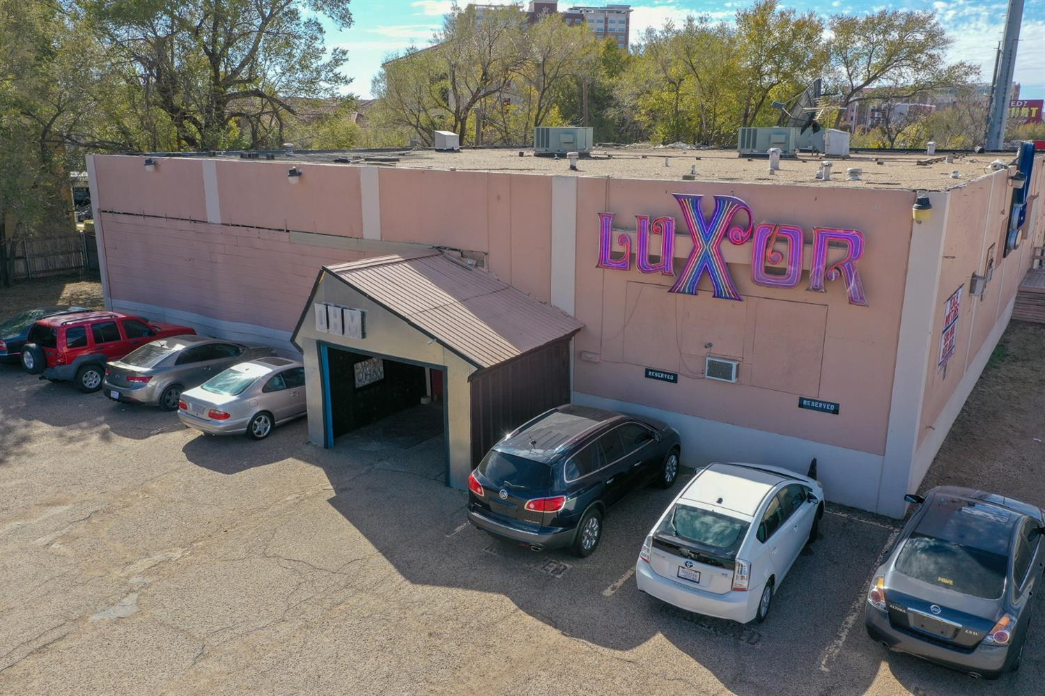 Long-time Lubbock nightclub in Overton Park on US 62/82 is now available! Sitting on almost an acre with nearly 350 feet of US 62/82 (Marsha Sharp Freeway) frontage this property is ideal for multiple uses. Currently operated as a nightclub, this property has everything for someone looking to purchase for entertainment or club/bar. From the iconic lighted dance floor to the large elevated DJ booth, this is one of the most technically advanced and well-known clubs in the region. The property boasts 3 separate bars, 6 bar stations, separate VIP lounge downstairs with separate entrance, lighted staircase, green room/dressing room, raised platforms with poles, tons of storage, three 10-ton HVAC units, and an owned POS system. With almost an acre of paved land and the building set to the far west, this property is also perfect for other commercial uses of expansion or redevelopment including retail, multi-family, or student housing. Currently zoned Interstate Highway commercial.