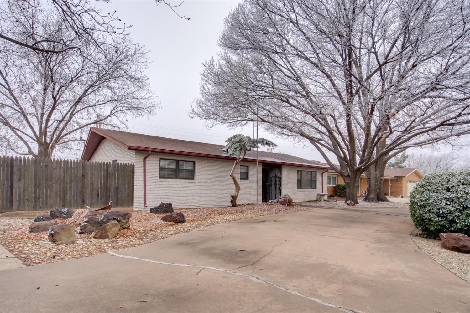 Hard to find 3/2/2 with RV parking located near Tech!  You won't want to miss seeing this one featuring an open concept floor plan with spacious rooms and the cutest back yard.  The corner lot offers plenty of space for parking along with a circle drive, rear entry garage and RV parking in the back all enclosed with an electronic gate.  The adorable kitchen provides plenty of workspace and a large breakfast bar while the living area offers a cozy fireplace.  With many extras such as updated lighting, plantation shutters and a new roof coming you'll want to add this to your must see list.