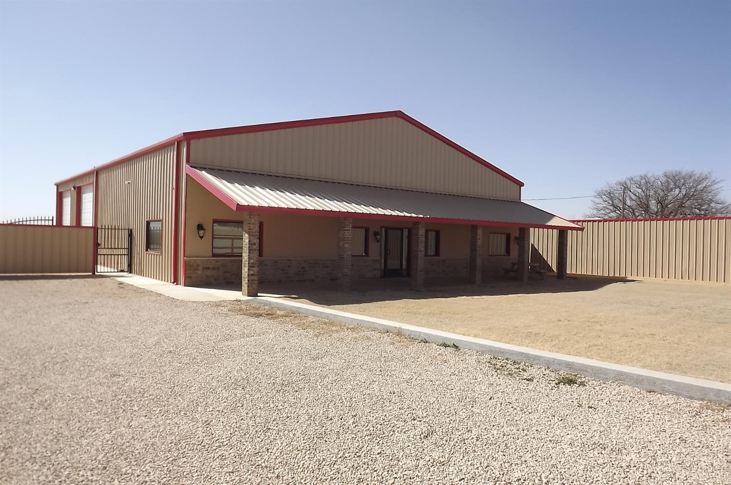 A 4800 SF Office/Warehouse like new (built 2018) on 1 Acre with crushed rock stack-parking lot,    completely fenced with automatic gate, 3-14' overhead doors with openers, Private well and septic with front yard irrigation, Offices, conference room build-out complete w/ granite countertops, built-ins, insulated shop, epoxy concrete floors in both shop office and shop. Led lights, RV hookups, 30-50 Amp service. This is super nice and close to I-27 and Lubbock Executive Airport.