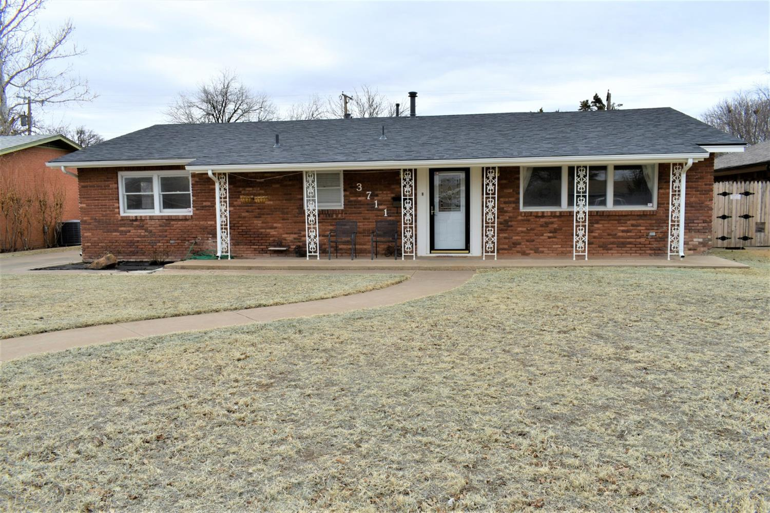Fabulous home with nice large front porch, newer windows, and has no paint siding!  Basement!  Recent flooring and paint!  Two living areas!  Rear entry garage!  Large patio area!  Sprinkler and security system!  Home Warranty for new buyer!  Better hurry!