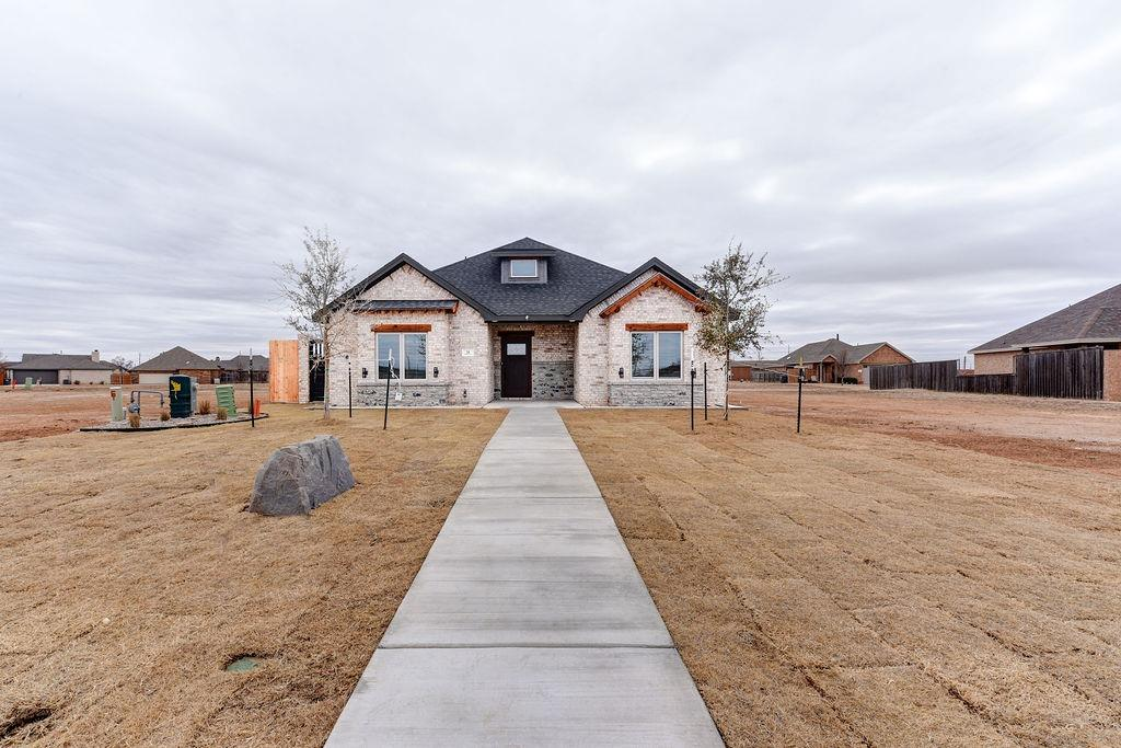 Welcome to this beautiful new home built by Rustic Homes in Lubbock's newest gated community, Cantera! This 4/2.5/2 home offers custom cabinetry, granite countertops throughout, vaulted beam ceilings, and an open floorplan that is perfect for entertaining! You'll love the abundance of luxury features that makes this house stand out: instant hot water, convection oven, built-in timer for Christmas lights, wine fridge, bluetooth garage door opener and more! Schedule your private showing today!