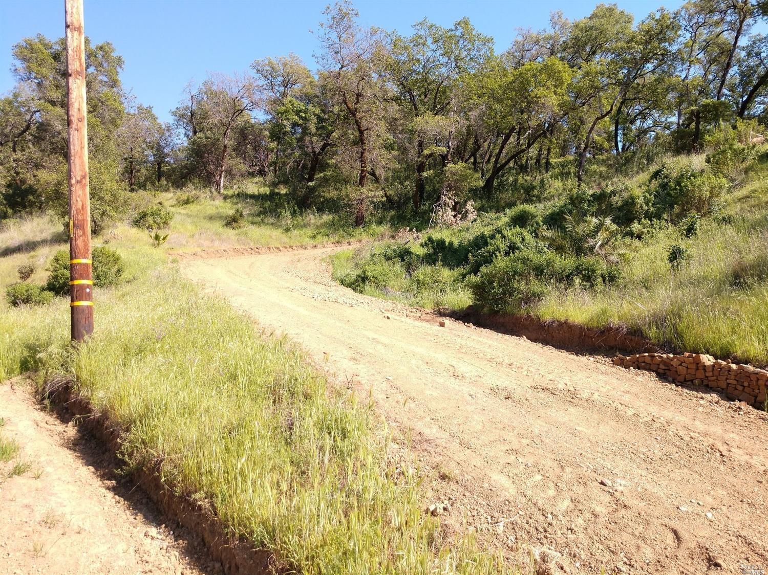 Nice building parcel in Napa Co. Creek runs through parcel. Oaks Madrones and Pine trees. Wildlife and within mins. of Lake Berryessa.