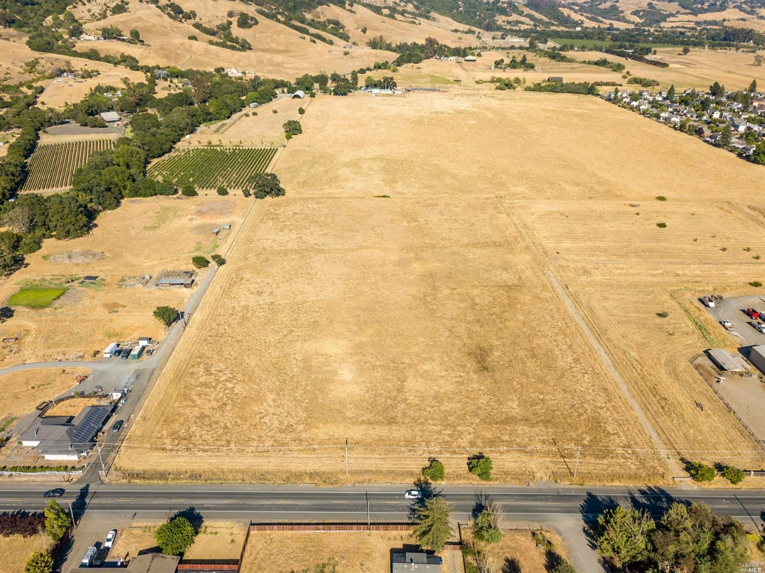 Perfectly flat and usable 11 acre parcel with beautiful views of the surrounding hillside. Located w
