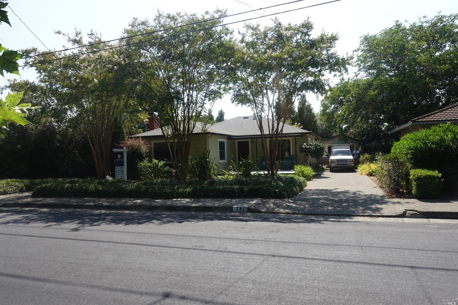 Walk to downtown and farmers market. Large landscaped lot. Hardwood floors. Fireplace. Lots of natural light.