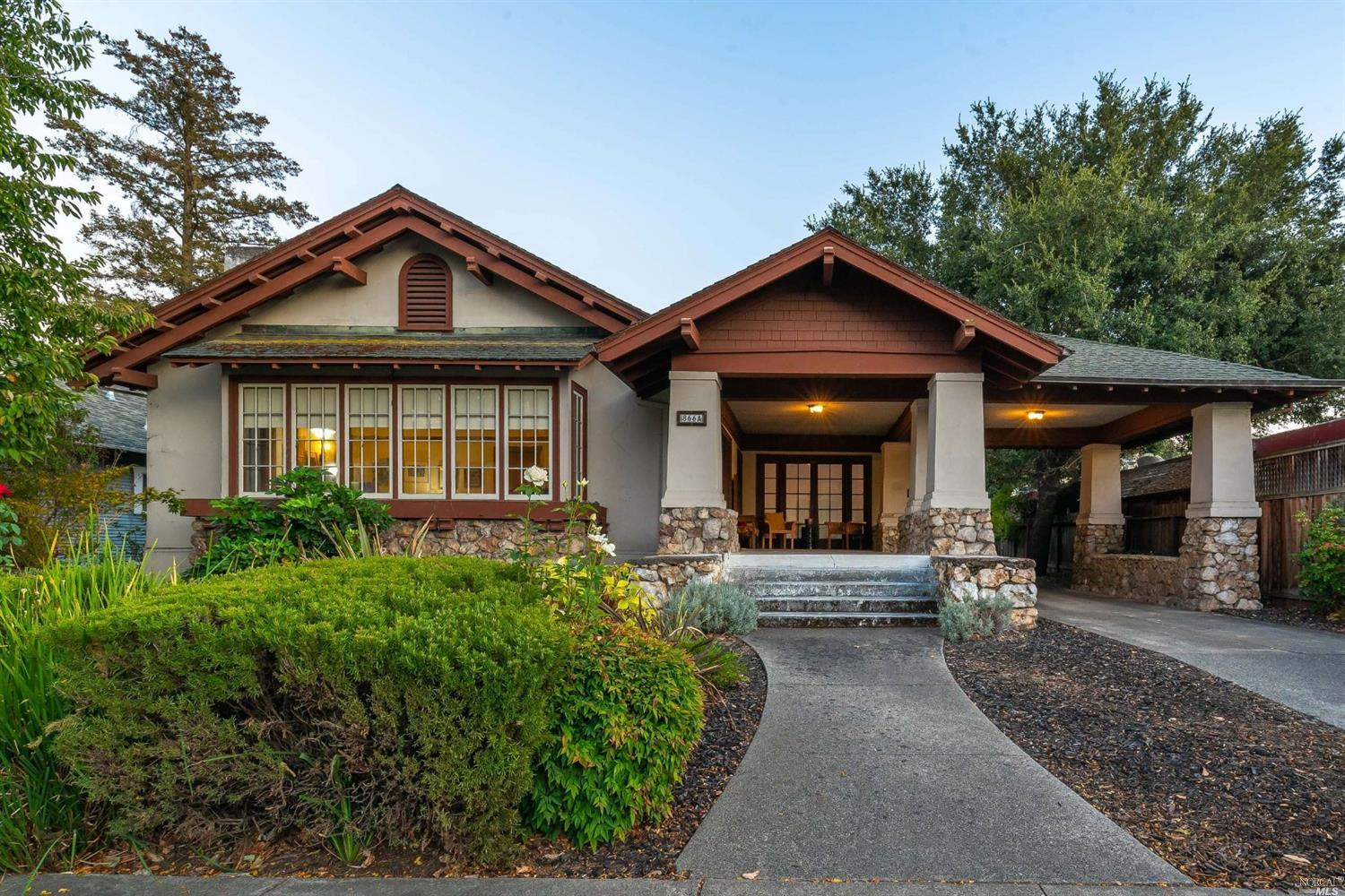 A rare find. 1915 Craftsman home with 2 rental cottages and large detached garage with bonus room. The .42 acre parcel is zoned Medium density residential. Main home is 2bd/1ba with large front porch, Formal living & dining room with beautiful wood accents and built-ins. There is a very special glass ceiling orchard room. New central heating. New windows in bedrooms, kitchen & bathroom. Walk out to the enclosed yard with newer deck. The kitchen has newer flooring, stove & dishwasher. Separate laundry room is off the kitchen. The 2 cottages are well maintained and have w/d hookups and garages. There is ample room for parking & possibility for additional units. Also listed as MLS #21925797 under Residential.