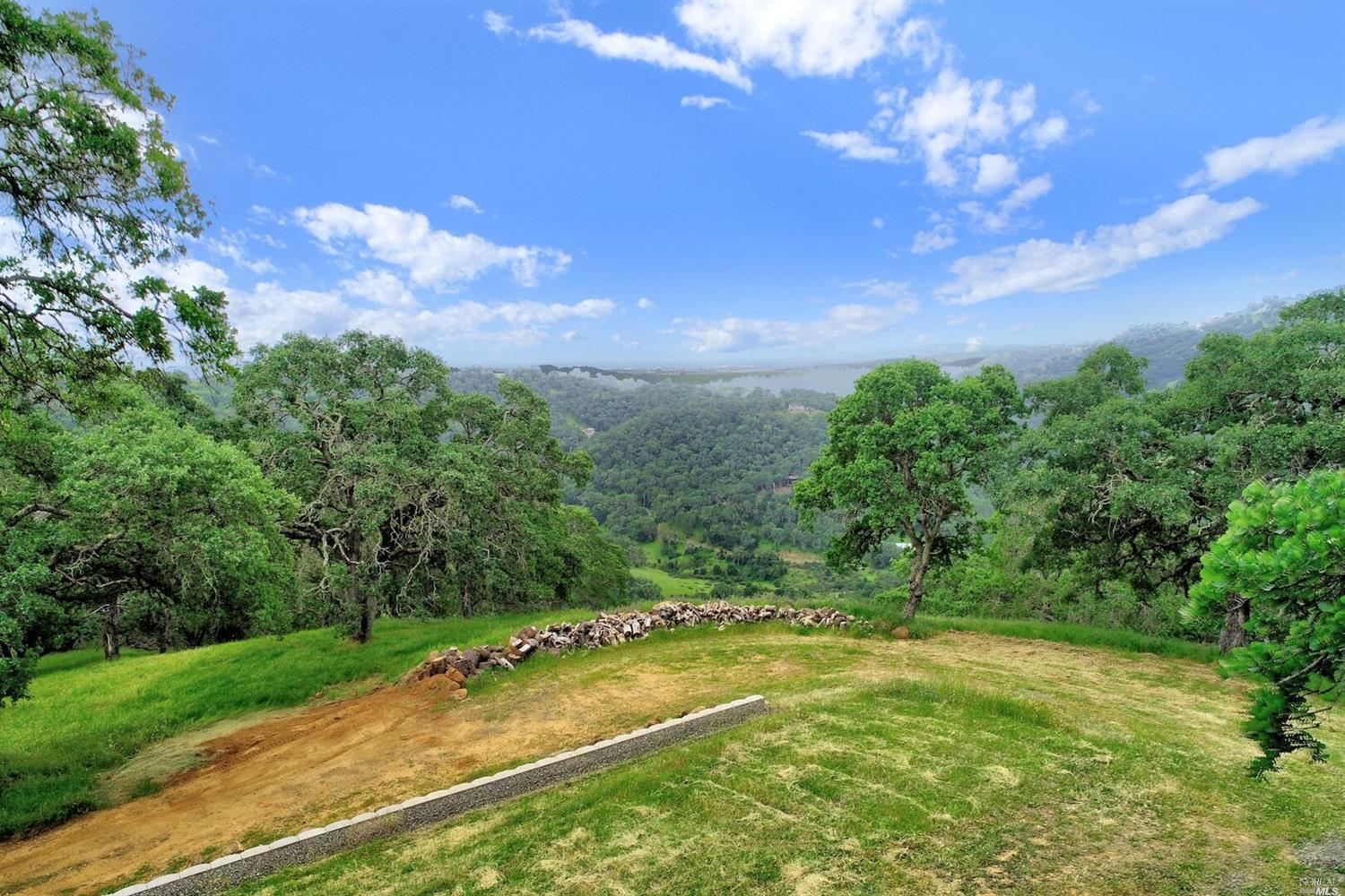 This Breathtaking 20 Acre property is gated off of Grandview Road. Located midway between Napa and Fairfield off of Gordon Valley Road. Situated atop of the hill with panoramic views overlooking Napa, Fairfield & Mount Diablo is Truly Unique. This property is ready for you to build your one of a kind dream home!