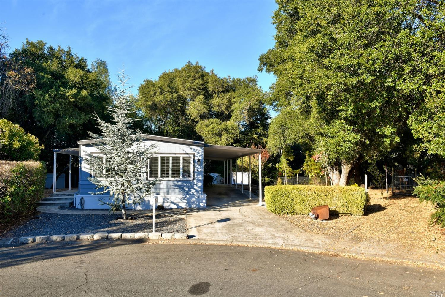 Ready to move in 2 bedroom, 2 bath mobile home at end of cul de sac. Light-filled living room with s