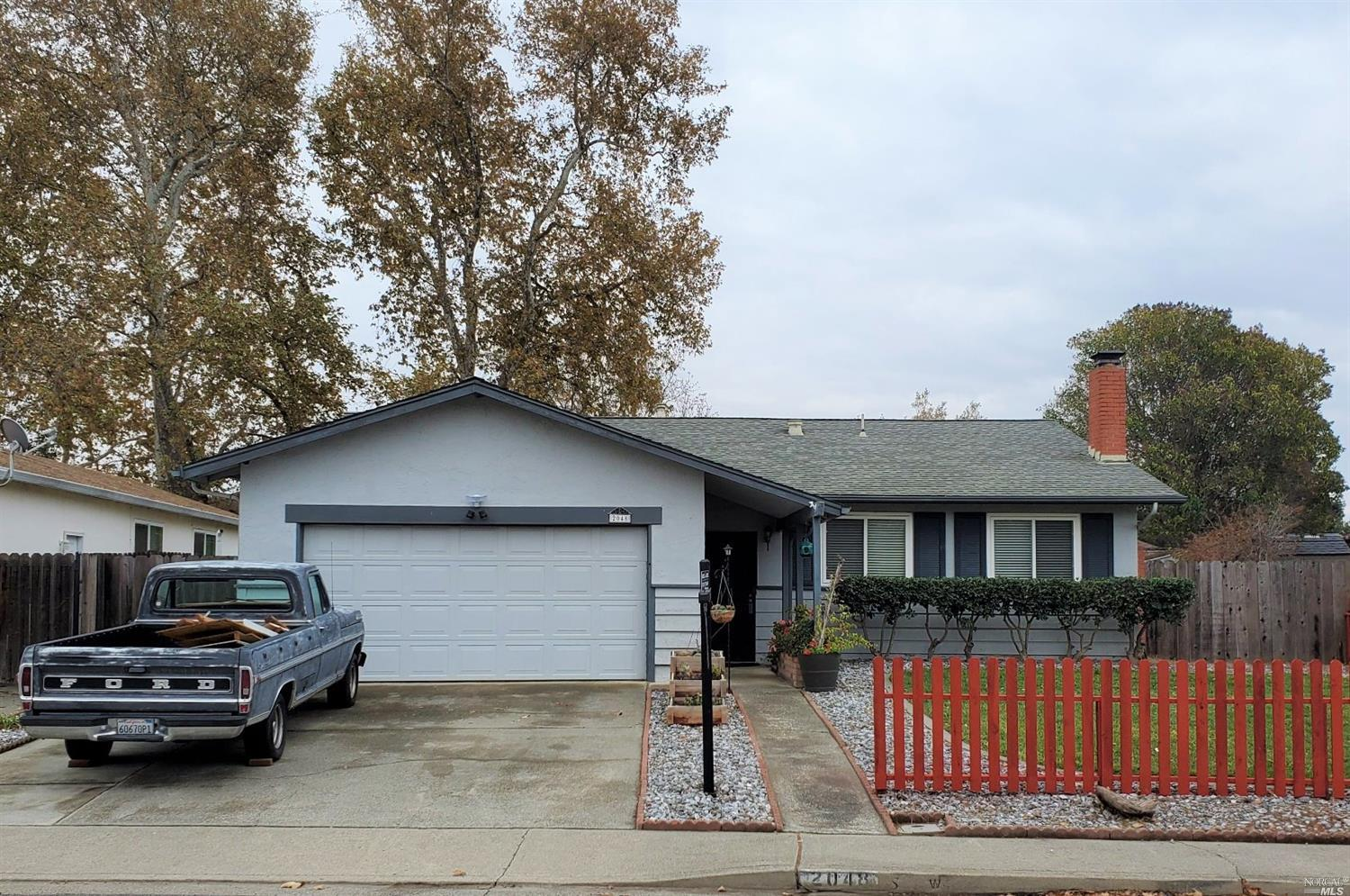 Charming 3 bedroom, 2 full bath home.  Spacious kitchen with eat-in bar area in open-floor plan with