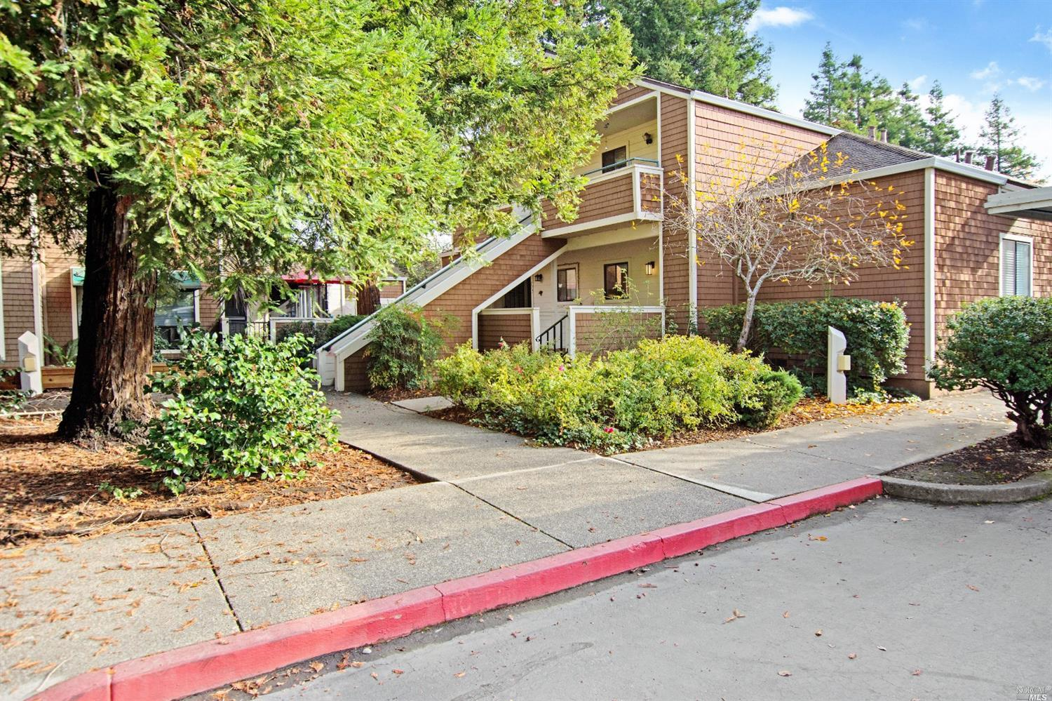Well maintained single story two bedroom, one bath condo in a gated complex. This end unit condo fea