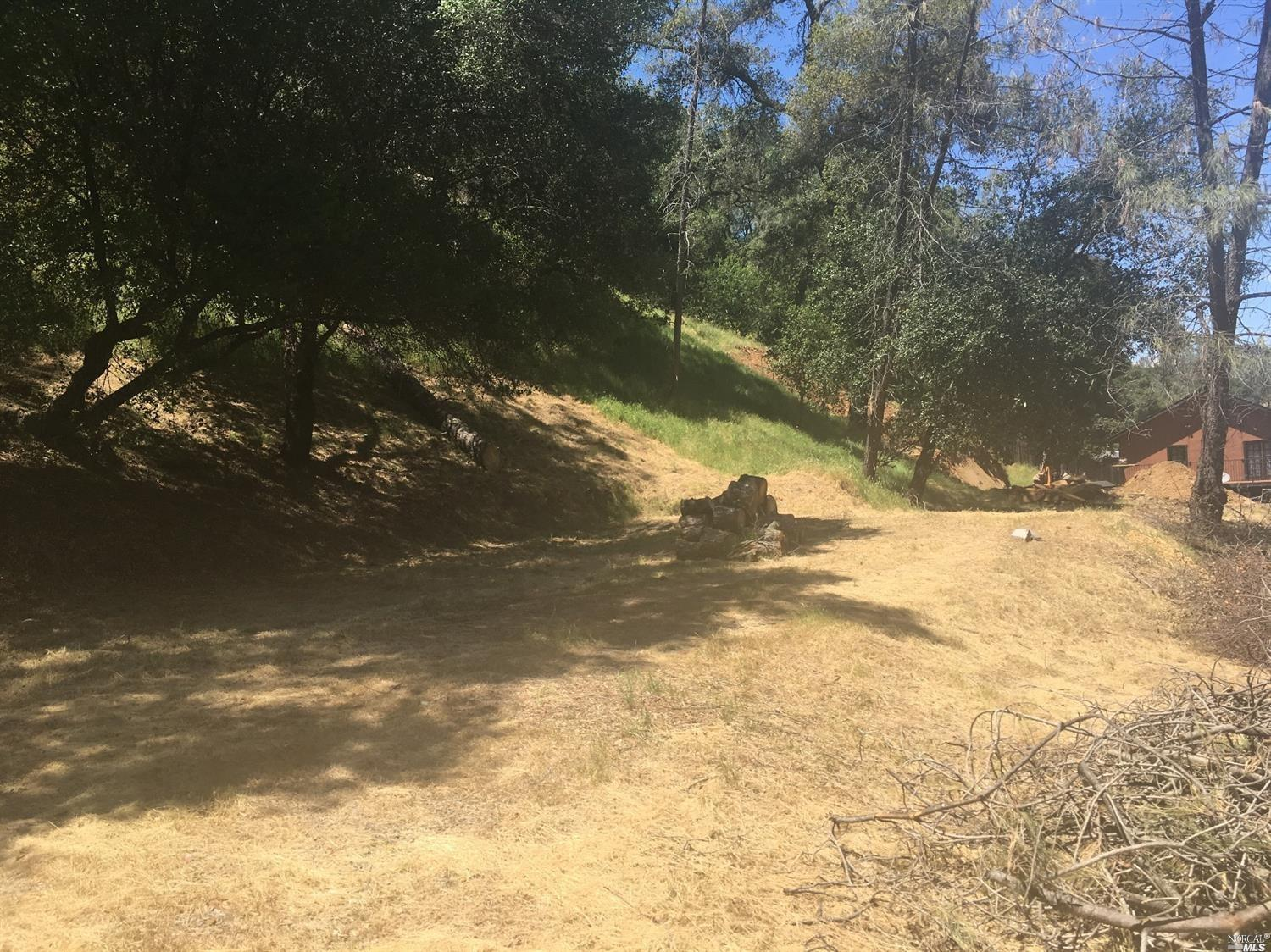Nice flat lot with up slope totaling 0.3778 ac in the Resort Community of Berryessa Highlands. The z