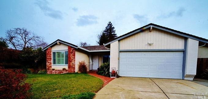 This 4 bedroom, 2 bath Single story home located in desirable East Vallejo neighborhood is waiting for your personal touch to make it your own! Updated bathrooms and flooring, plantation shutters and newer dual-paned windows. Spacious formal living room; dining room and family room with vaulted ceiling and fireplace. A slider leads to a large covered patio and private, landscaped backyard. Perfect for entertaining! Laundry room and 2-car attached garage. Refrigerator, washer/dryer included.  Quiet neighborhood, just off of Columbus Pkwy, An easy commute to San Francisco, Sacramento and the wine country, just minutes to the Vallejo/SF Ferry!