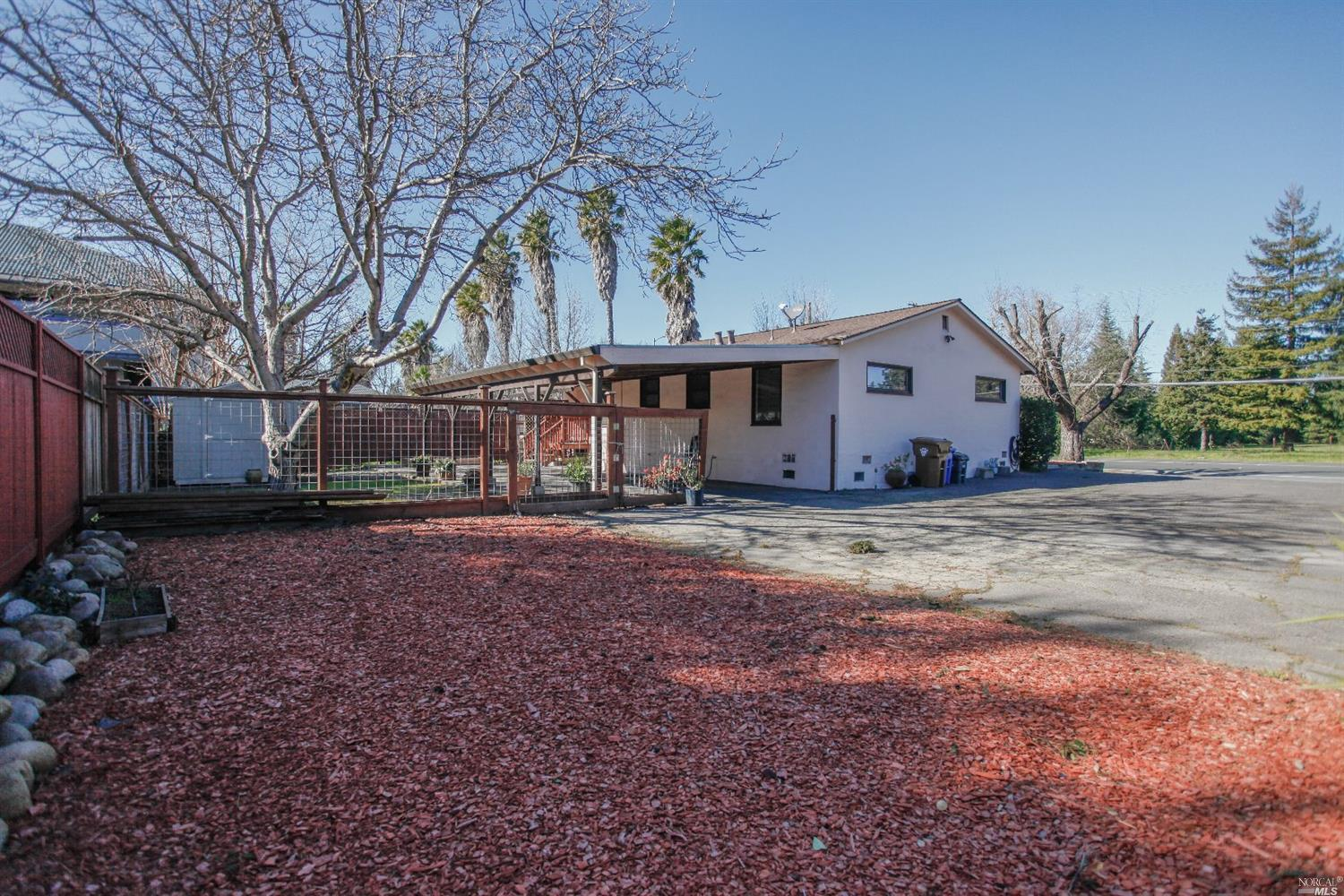 Mid-century home near Downtown with extensive upgrades completed in 2005. Newer roof (2016), tankless water heater (2018), and beautiful landscaping. Currently used as a residence. Zoning is Community Commercial which allows for a wide variety of uses. Some improvements may be required depending on use. Best to check with City Planning.  Also listed as MLS#22002357 in the commercial category.