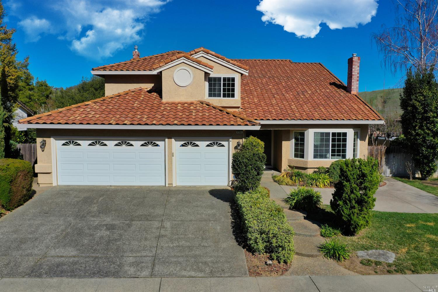 Lovely updated home in gated golf course community of Rancho Solano. Very private setting, no front