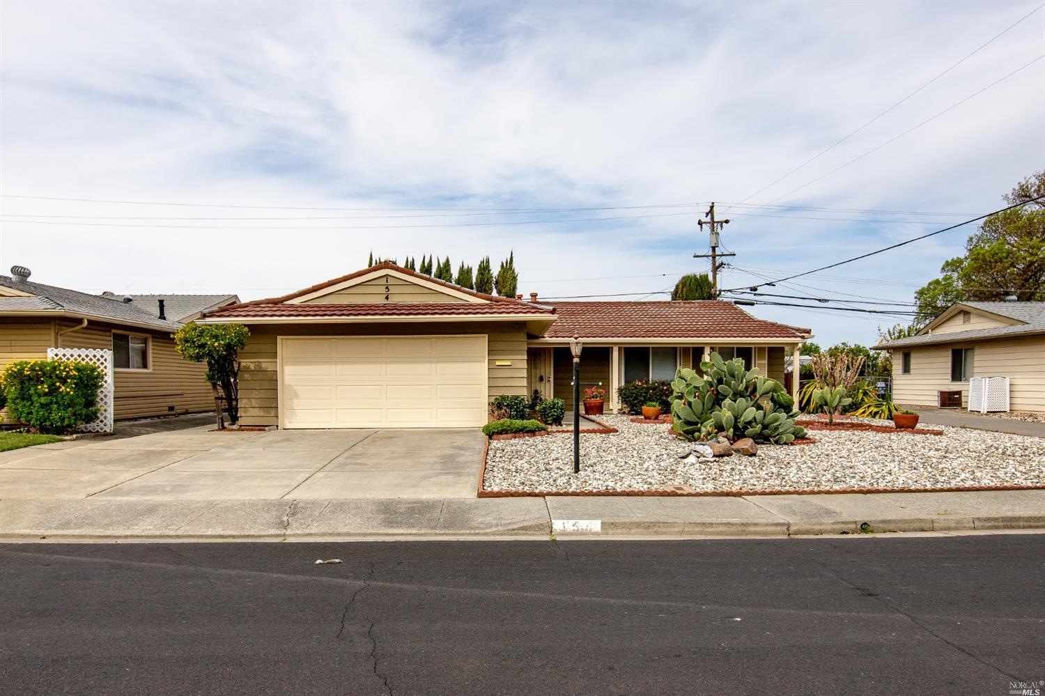 Very nice single story home featuring tile roof, laminate floors, new windows, updated bathrooms, ne