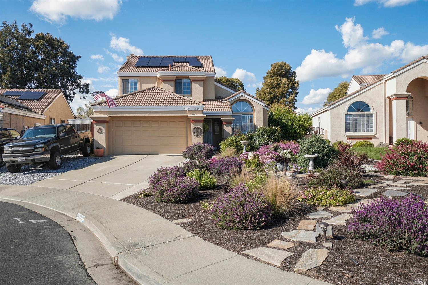 Curb appeal is the first thing you notice about this home! Large drought tolerant front yard with be