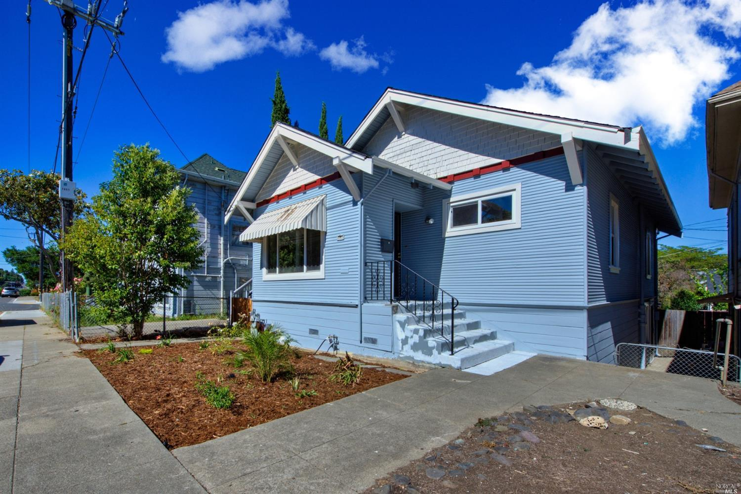 Charming Bungalow with plenty of natural light! This home features 2 bedrooms, 1 bathroom and a low