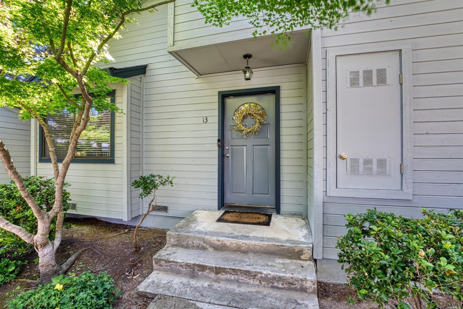 Single level 1BD/1BA corner Condo nestled within the redwoods at Village Parkway.This home feels  bi