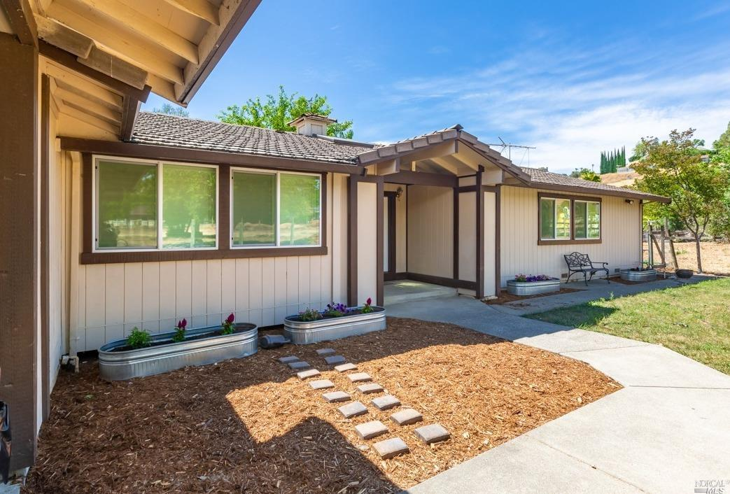One of a kind Vacaville property. Home is a beautiful one story that sits on 2.35 usable acres. This property has something for everyone. There is a 5 car/RV/boat/shop, swimming pool, & horse stable w/arena! The home has 4 bedrooms, 3 full baths, all with new paint, flooring, fans & baseboards. The remodeled kitchen has a extra large island that can seat up to 4 people, double ovens, under counter lighting, stainless steel appliances, & a large walk in pantry off the barn door. Laundry room/mudroom is off kitchen & one bedroom/bath are attached. Two separate large living areas one w/a fireplace & the other w/a bench seat that overlooks the front of the property. The large master suite has a walk in closet, newly remodeled bathroom, & slidin
