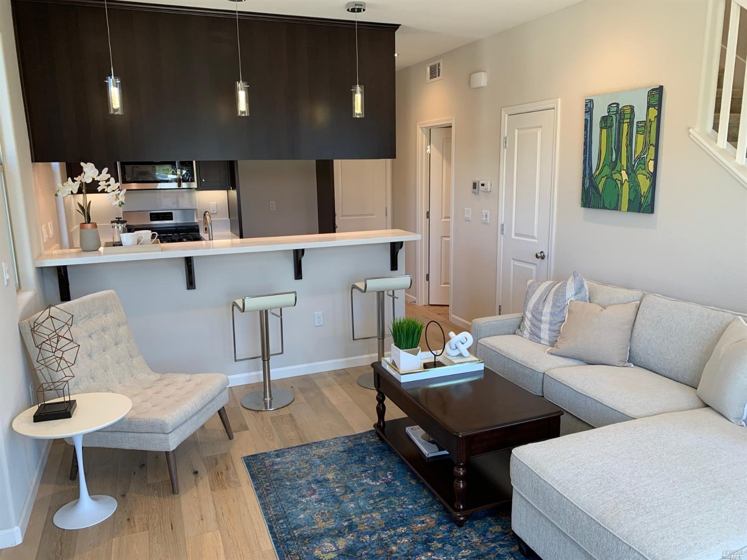 New Napa Home!  Close to Shopping and Transportation. Modern floor plan features Kitchen, Breakfast Bar, Living Room, 1/2 Bath and Garage with interior access on Main Floor.  Spacious Suite with Walk In Closet and Den Suite on Second Floor.  Tankless water heater, Central Heat and Air Conditioning.