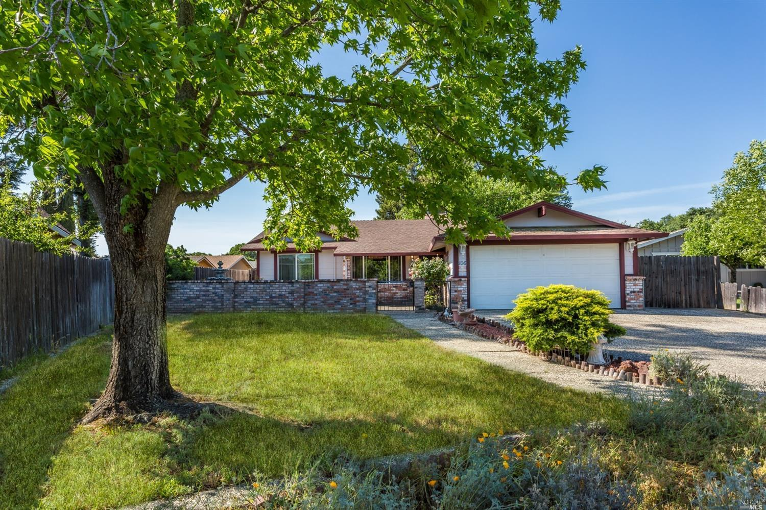This Vacaville Rancher is outdated but packed with potential! The brick walled courtyard welcomes yo