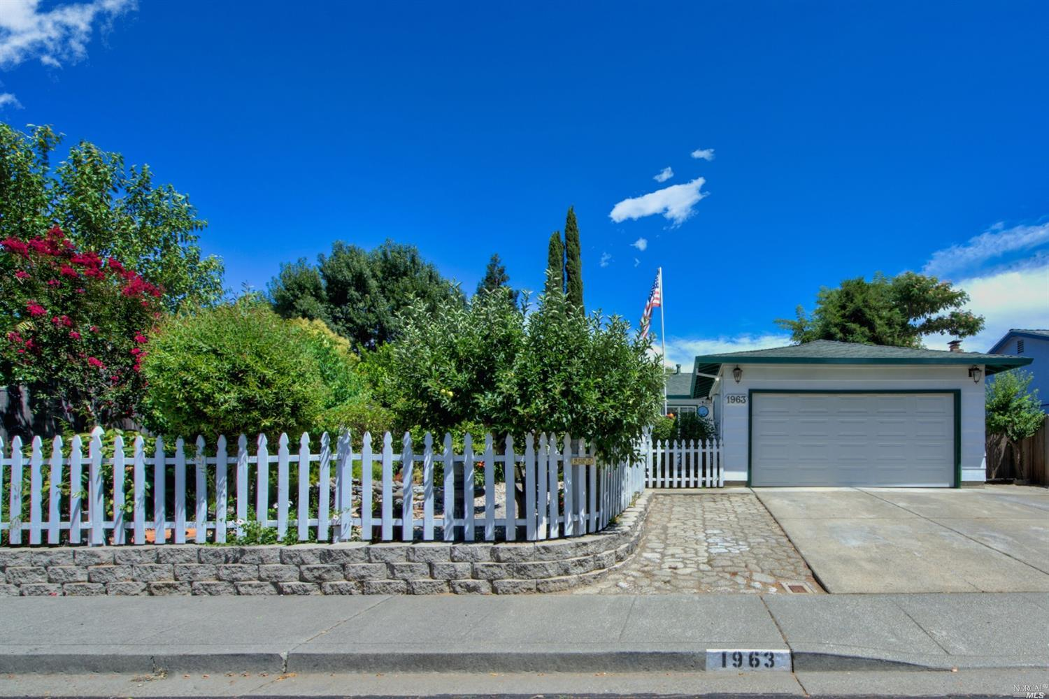 Well cared for single story home beautifully landscaped. Enjoy the privacy in the front garden area