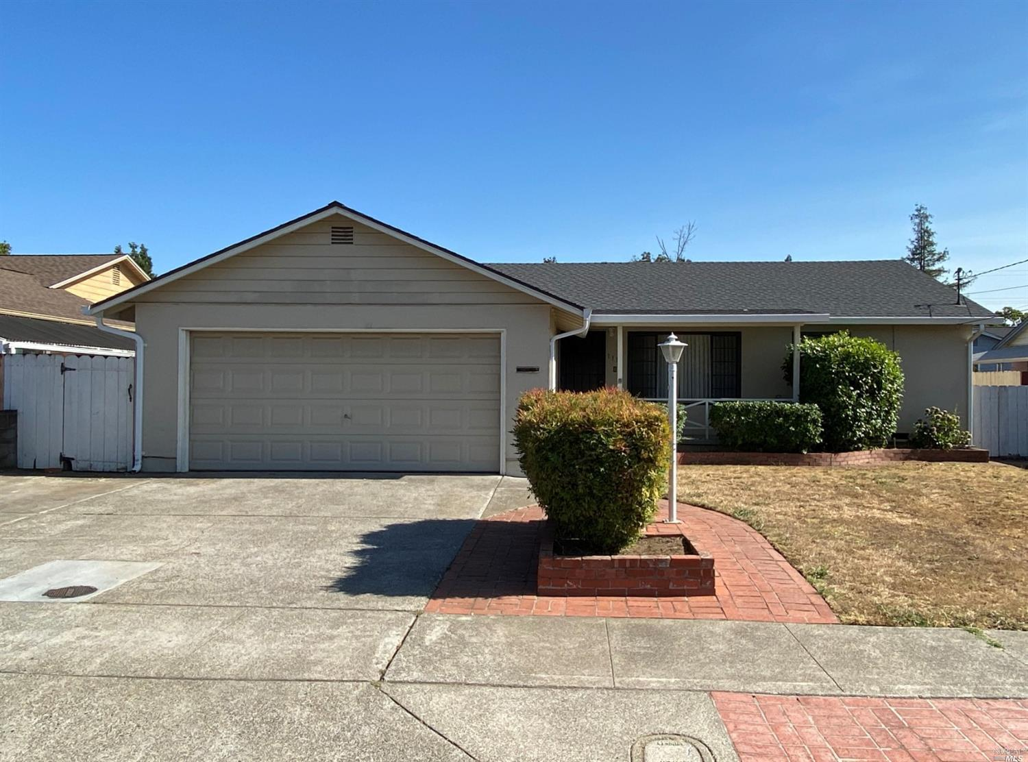 South Napa single level home with wood floors, bathroom with shower over tub. Central heat, no A/C,