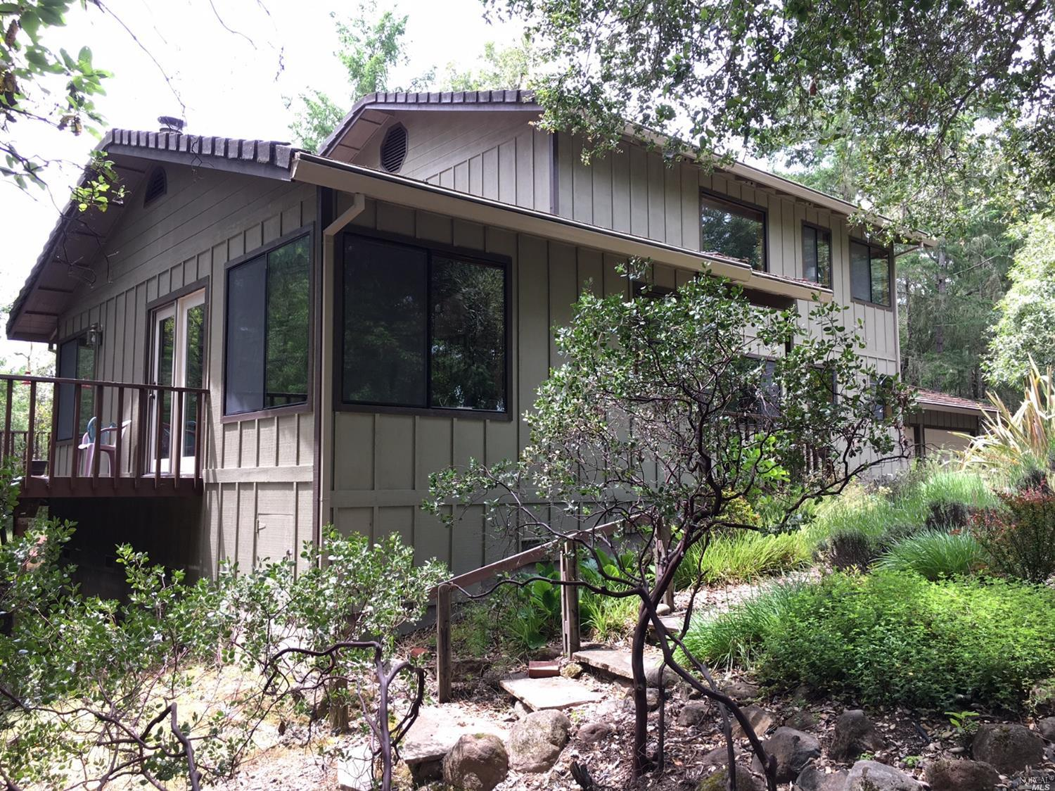 Nature lover's haven. Surrounded by redwood, oak, and madrone, this hilltop home offers privacy, quiet except for birdsong, and 24.5 acres of wildlife. Front garden certified as wildlife friendly by National Wildlife Federation. Private, Custom 2 story home with lots of wonderful features including Large Ground Level Suite!!! Very well maintained by original owner & offers open floor plan & decking.