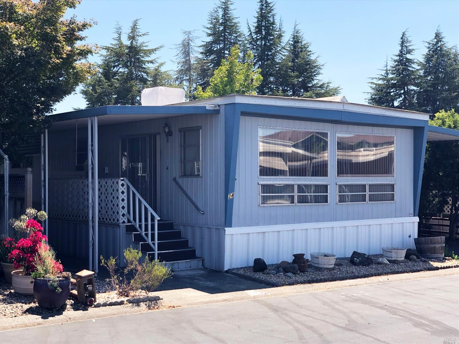 Excellent and Affordable Housing! This 2 BD 2 BA mobile home has a swamp cooler for air, newer centr