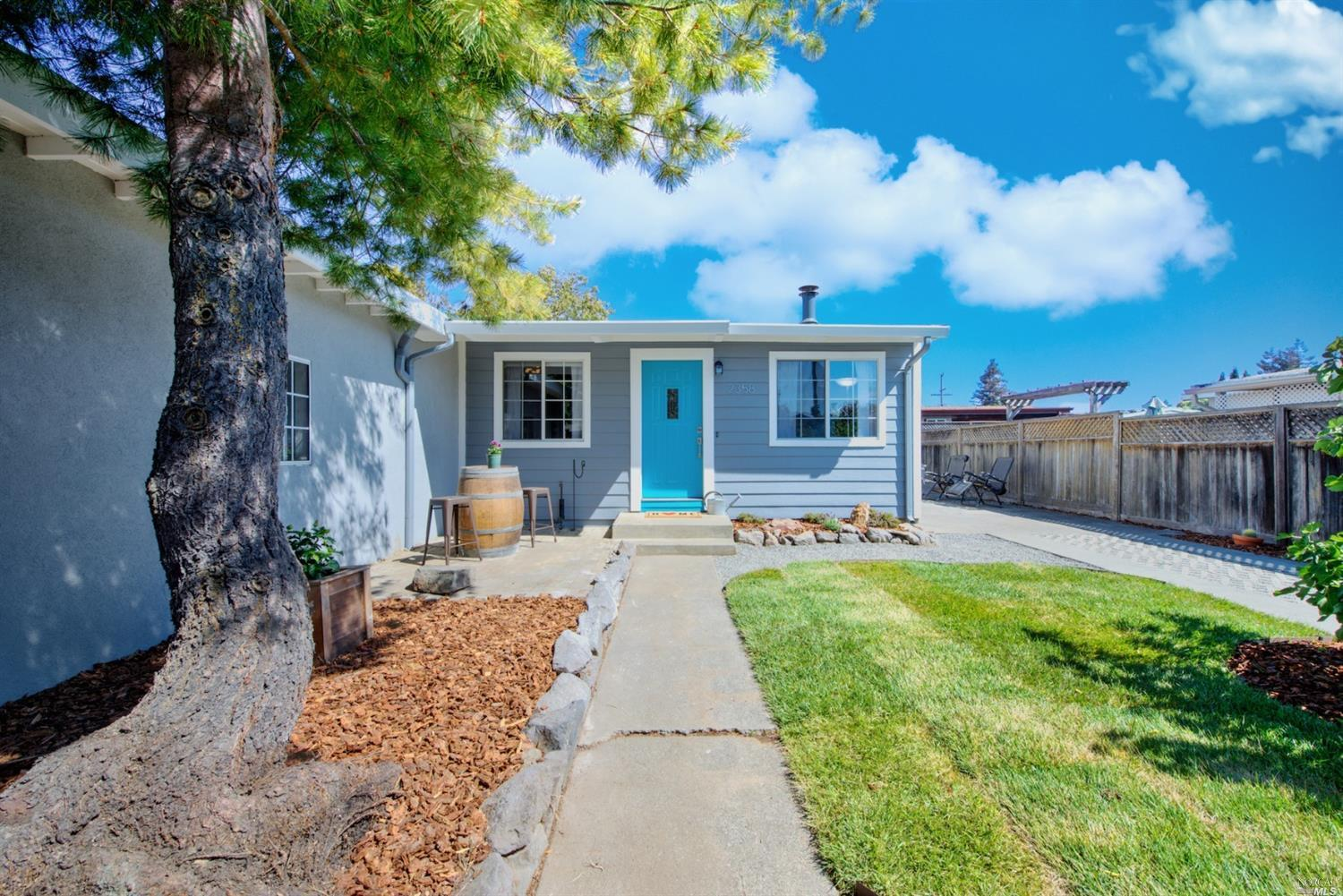 Delightfully updated mid-century modern single level home tucked away within a fully fenced yard. It