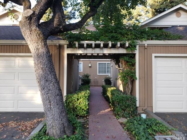 Amazing upper level unit surrounded by redwood trees park like setting with BEAUTIFULL WATER VIEW from the living room, bedroom and deck, laminate flooring throughout, all new paint, wood burning fireplace, cute kitchen including all new appliances, washer/dryer in the unit. Detached garage Easy access to freeways, walking distance to shopping centers, schools, and downtown. Great and quiet neighborhood.