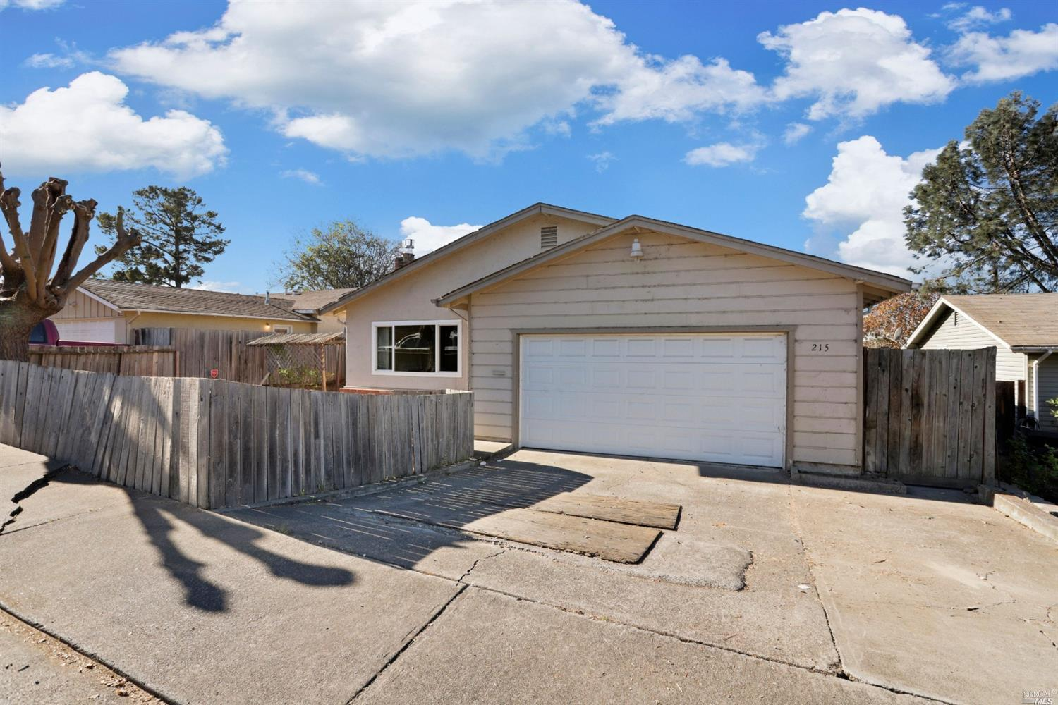 Mini Drive Area 3 Bedroom 2 Bathroom home, 2 Car Garage Attached! Level Backyard Lot with Covered Pa