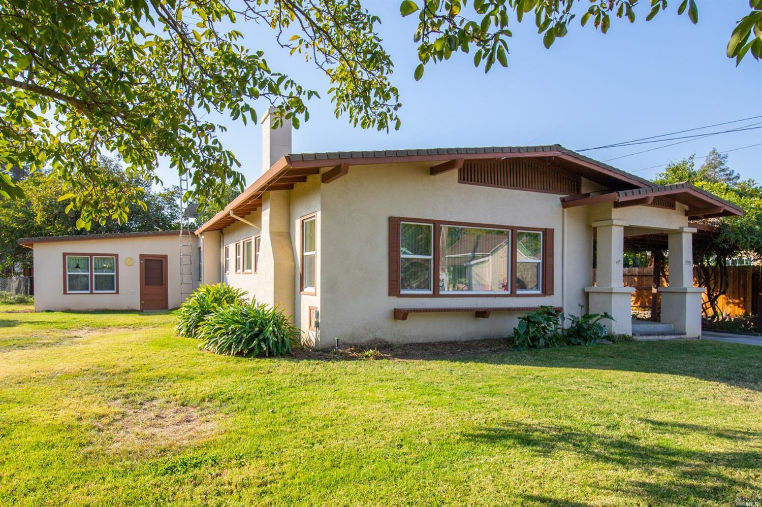 Charm of yesteryear complete with charming living room and formal dining room, large laundry room an