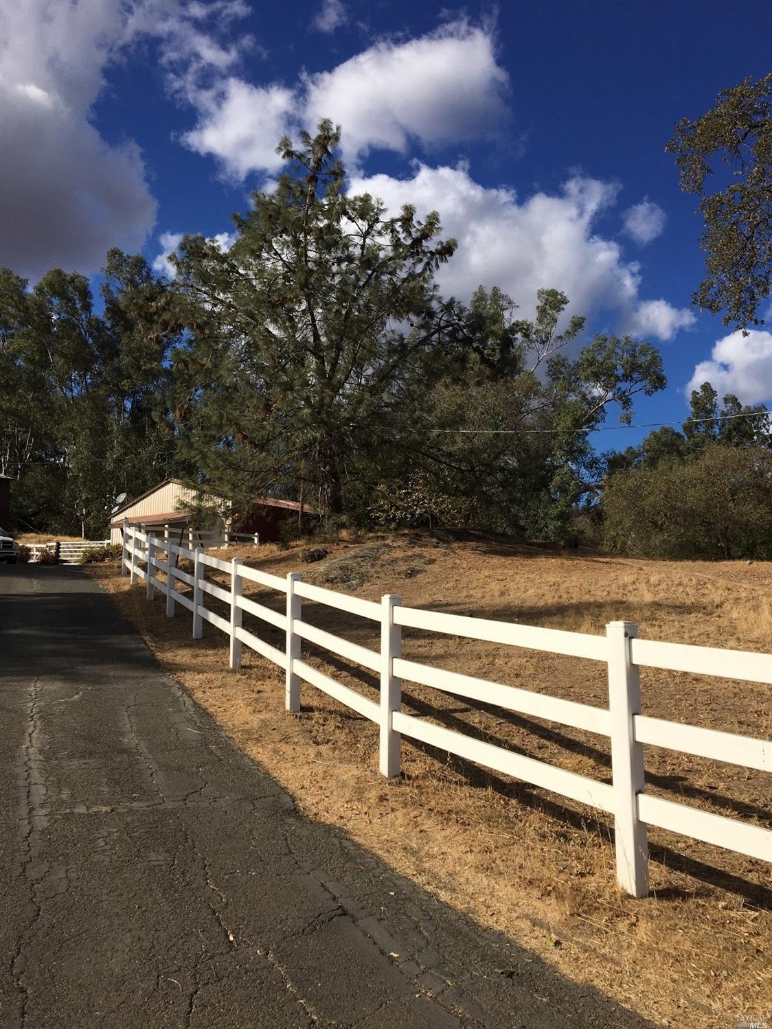 Two acres, single story country home with classic picket fence. Country property with private locati