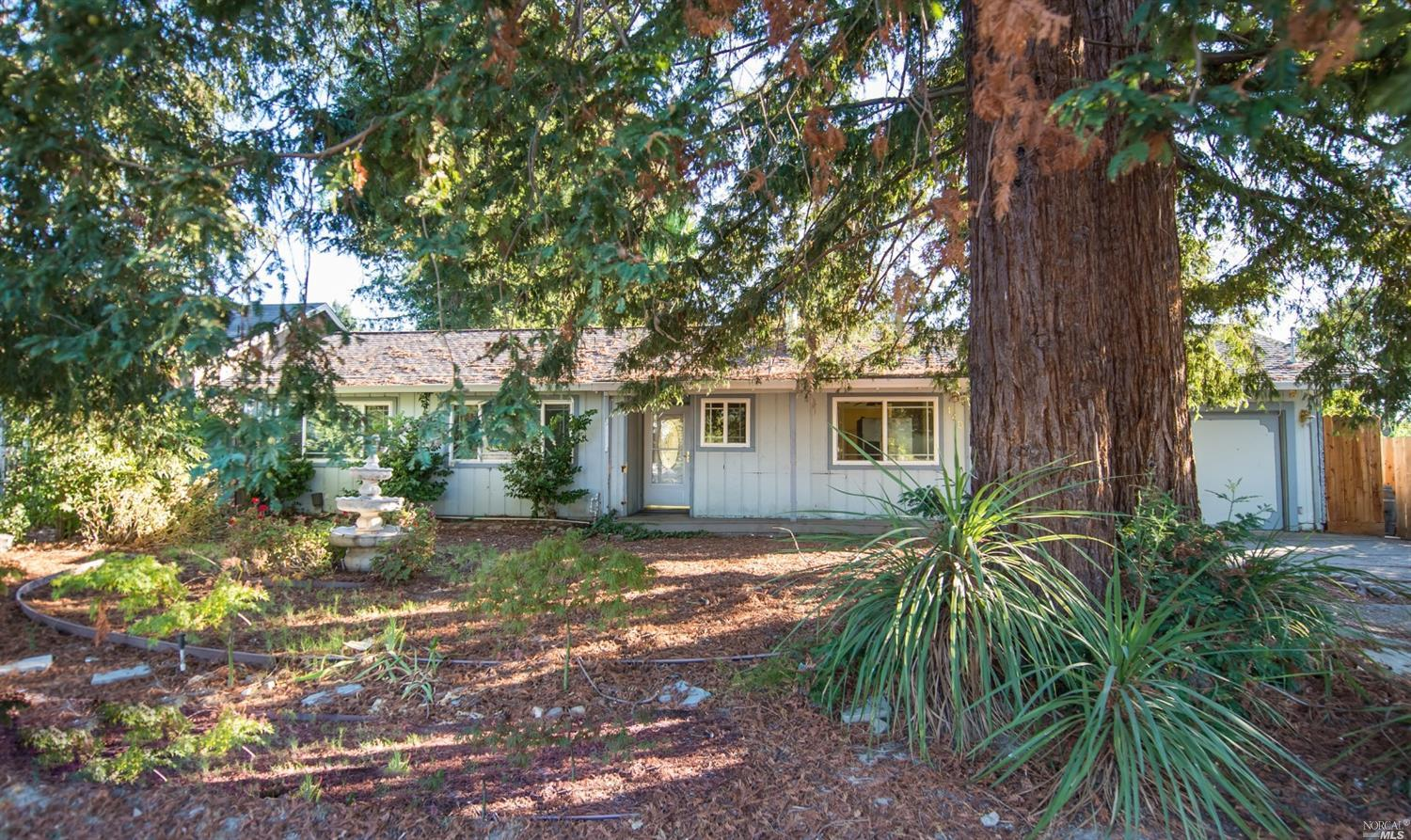 Fixer on great .27 Acre lot with outbuildings, mature landscaping and RV Parking. Newer roof, forced