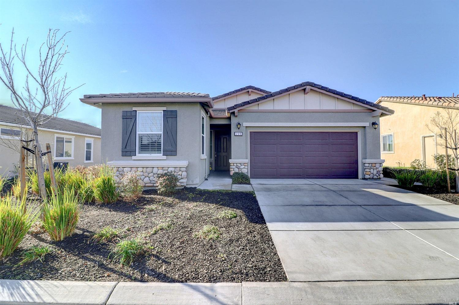 This beautifully upgraded like-new 2017 solar Solana enjoys a roomy lot and side yard with garden be