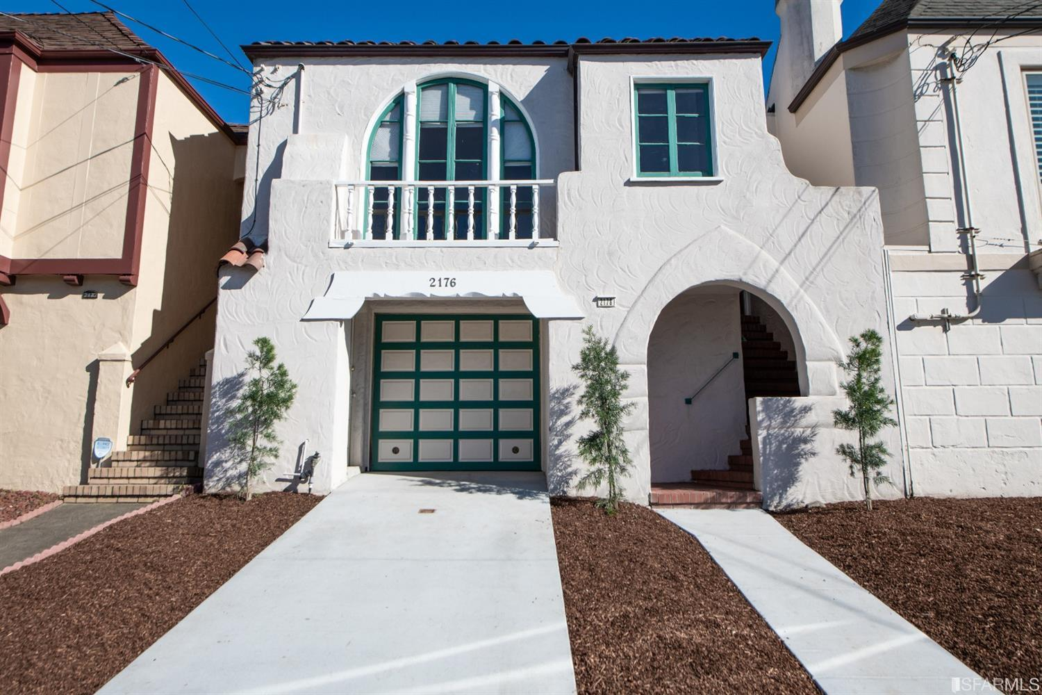 Front facade with a new driveway and walkway
