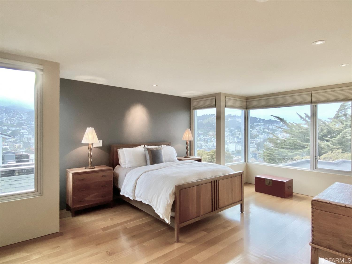 Exceptional master suite with sweeping panoramic views and a wall of custom-fitted closets. Access to roof area which was engine