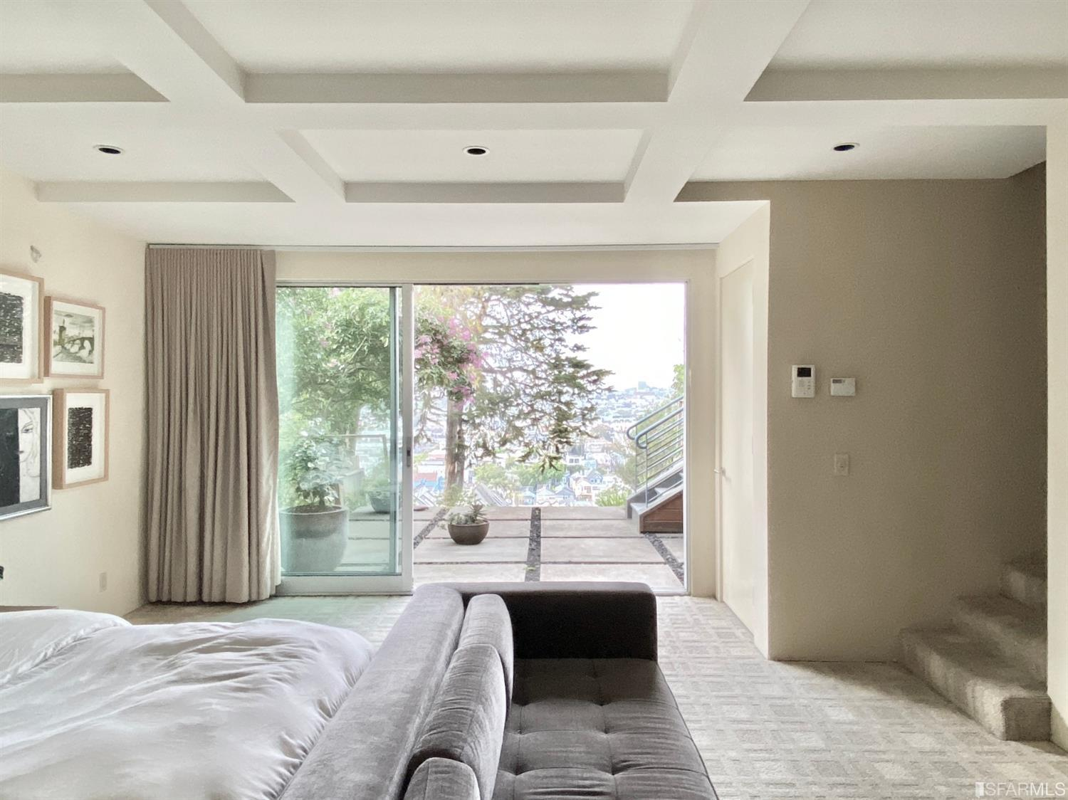 Garden level exceptionally spacious bedroom or media room with a half bath with stunning ceiling detail and floor to ceiling Fle
