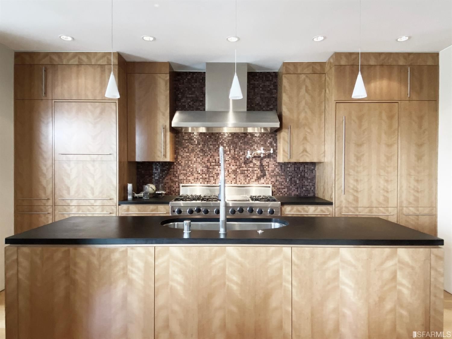 Designer chef's kitchen with eco-friendly PaperStone counters, beautiful custom natural wood custom cabinetry and counter-to-c