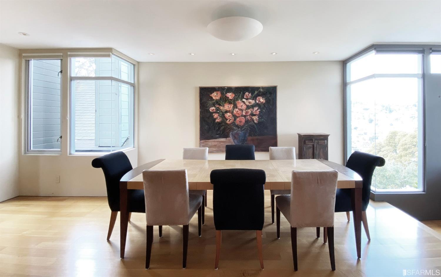 Expansive dining room easily accommmodates a table for 8-10 people and is flanked by the living room on one side and the step do