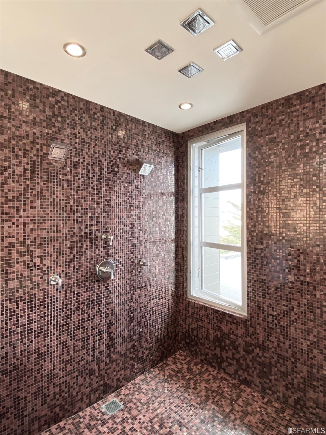 Master bath large double shower, double sinks and granite counters, and soaking tub and skylight. Adjacent to the bathroom is a