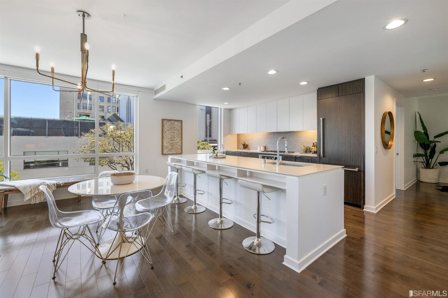 Welcome to The Marlow. Built in 2014, The Marlow is situated at the juncture of three Prime neighborhoods, Nob Hill, Russian Hill, and Pacific Heights. Residence 211 is the largest 2 bedroom, 2 bathroom + den floor plan they offer. Beaming with sunlight, this bright and airy south facing unit checks all the boxes including a private patio, in-unit washer and dryer, deeded 1 car parking, generous closets with custom shelving and organizers, and central air and heating. The well-appointed open floor plan includes a chef's kitchen with top-of-the-line stainless steel appliances, wide-plank hardwood floors, and floor-to-ceiling windows. Marlow offers 98 Modern, Luxurious condominium residences in the heart of restaurants, nightlife, shopping, and culture. Residents enjoy amenities including a lobby attendant, landscaped communal courtyard, bocce ball court, BBQ area, and outdoor fire pit/lounge area, as well as close proximity to Muni lines.