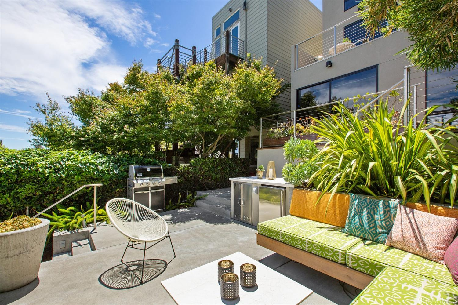 Walk-out decks from the main and lower levels overlook a fabulous southeast facing landscaped yard with built-in seating, lush p
