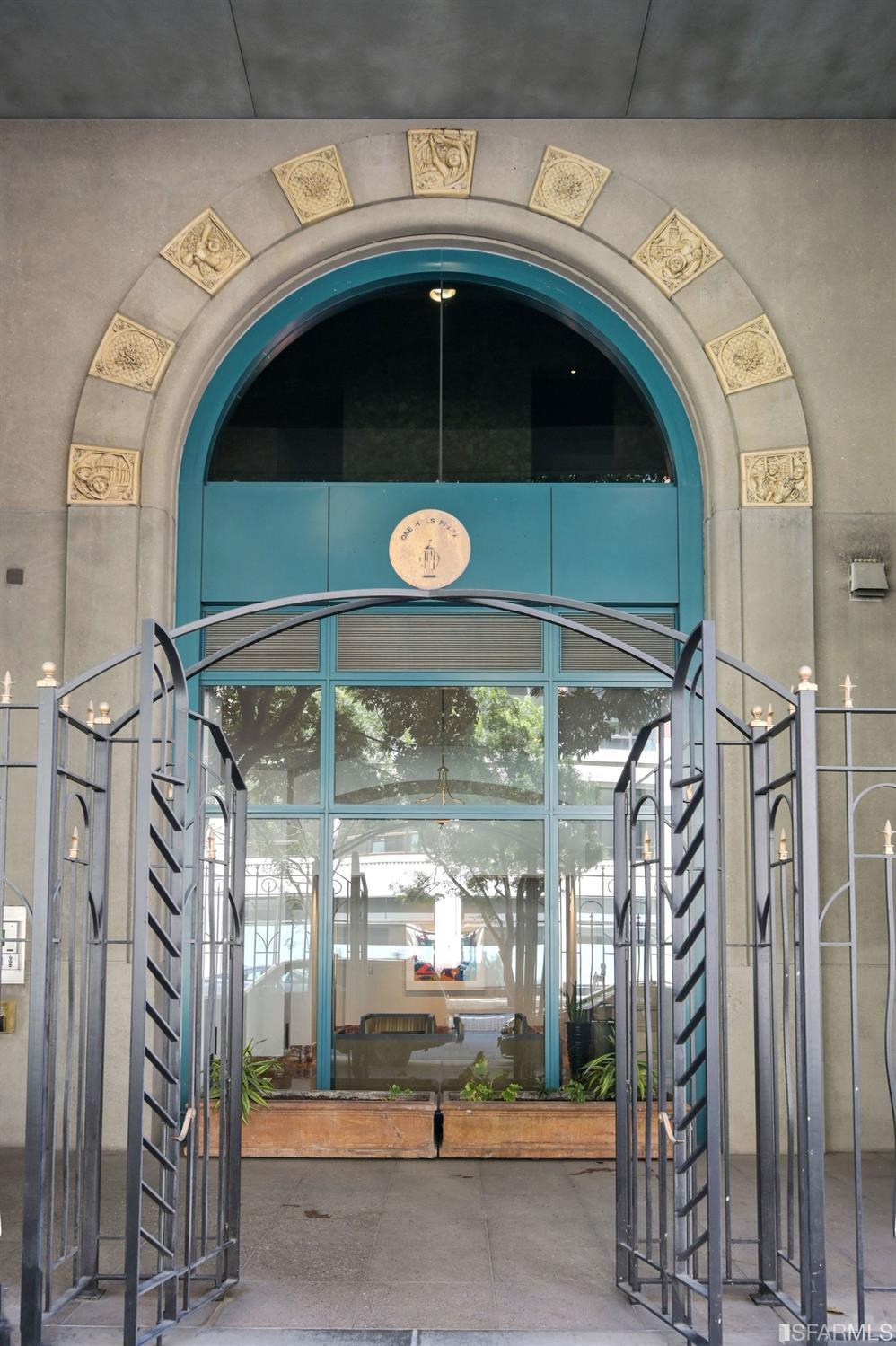 Residential entry emulates Hills Plaza, a National Historic landmark