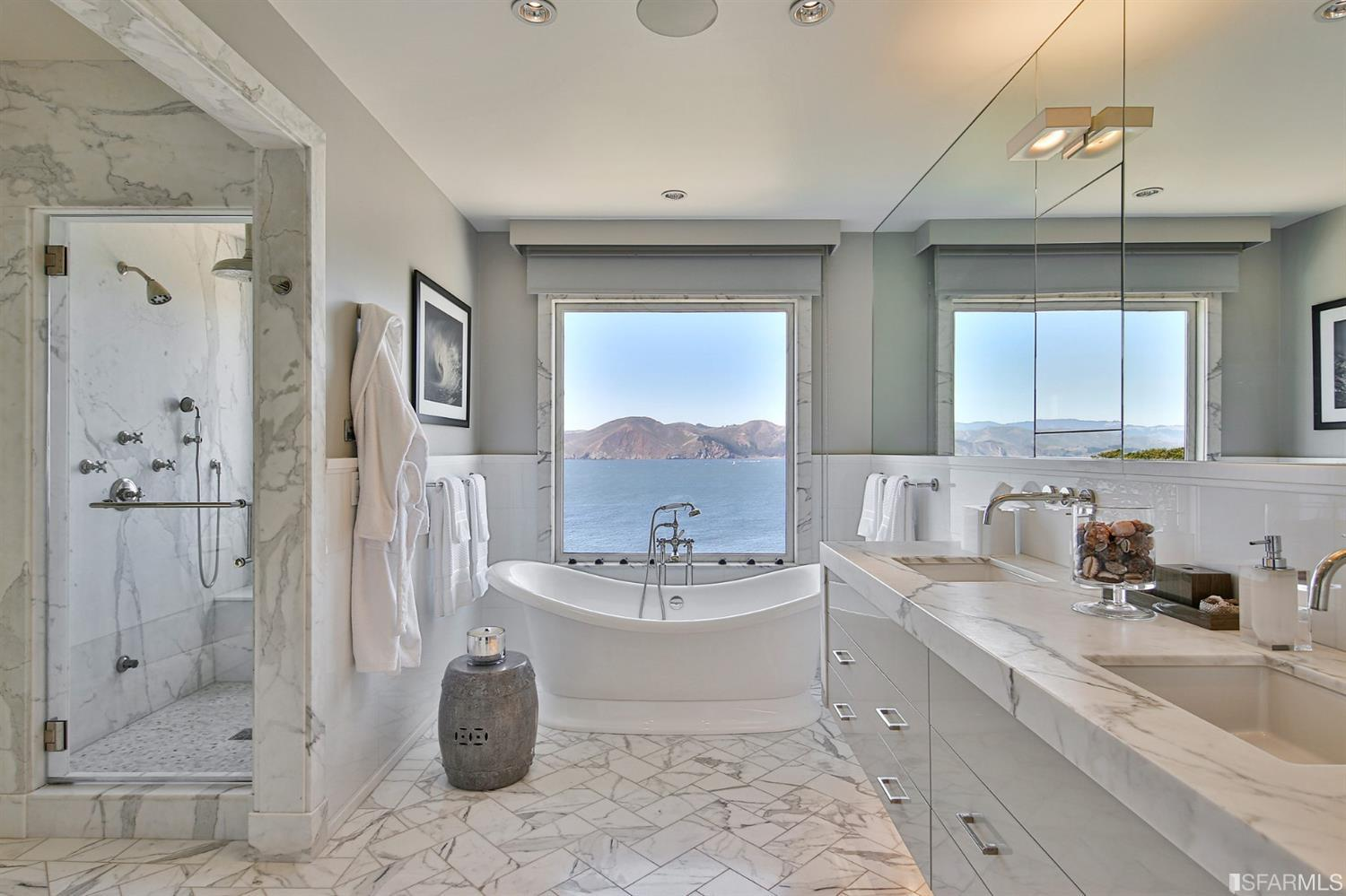 Luxurious Master bath with large soaking tub, steam shower, double vanity and those iconic views.