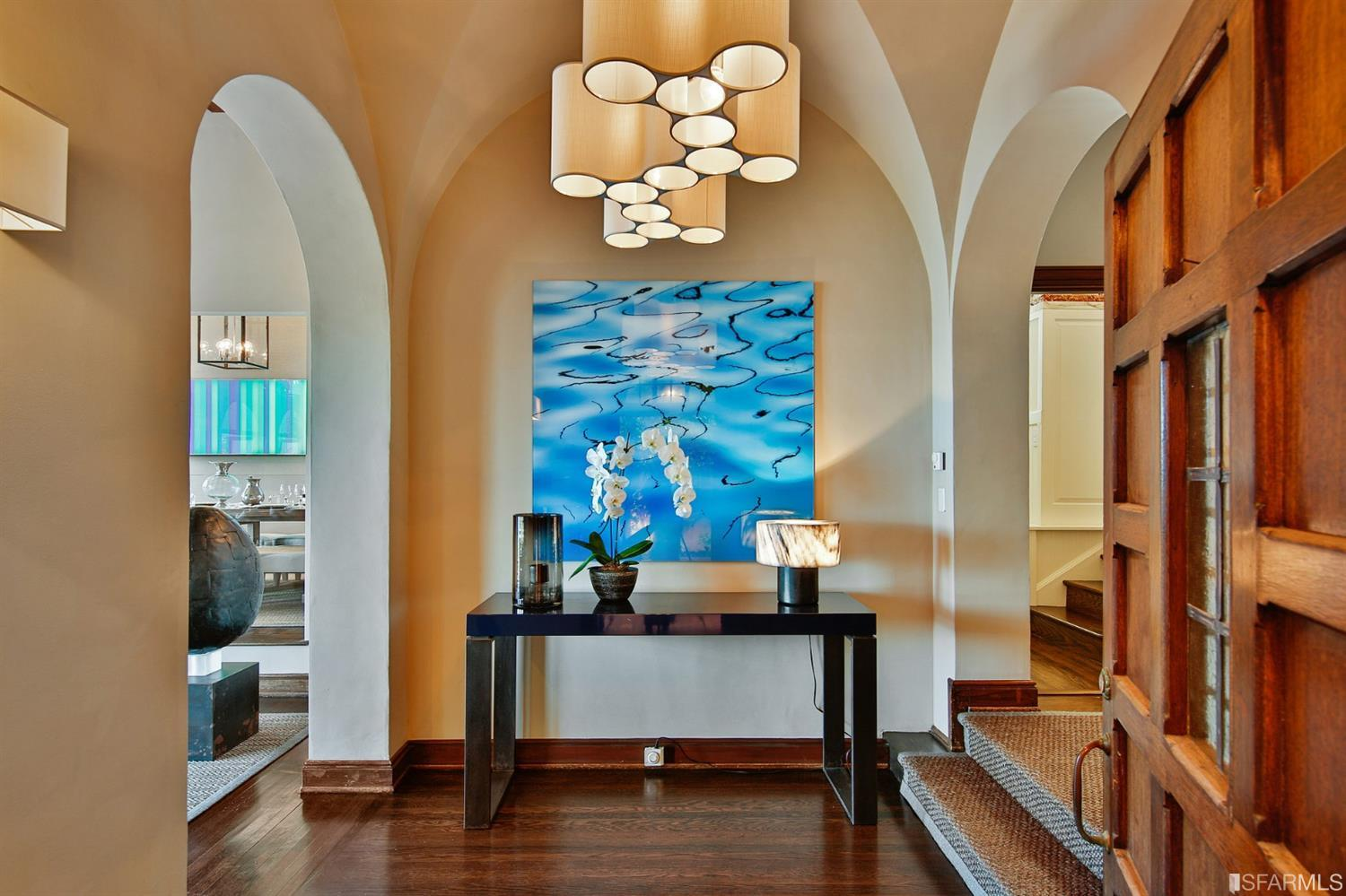 Handsome entry foyer w/modern lighting and stunning architectural details.