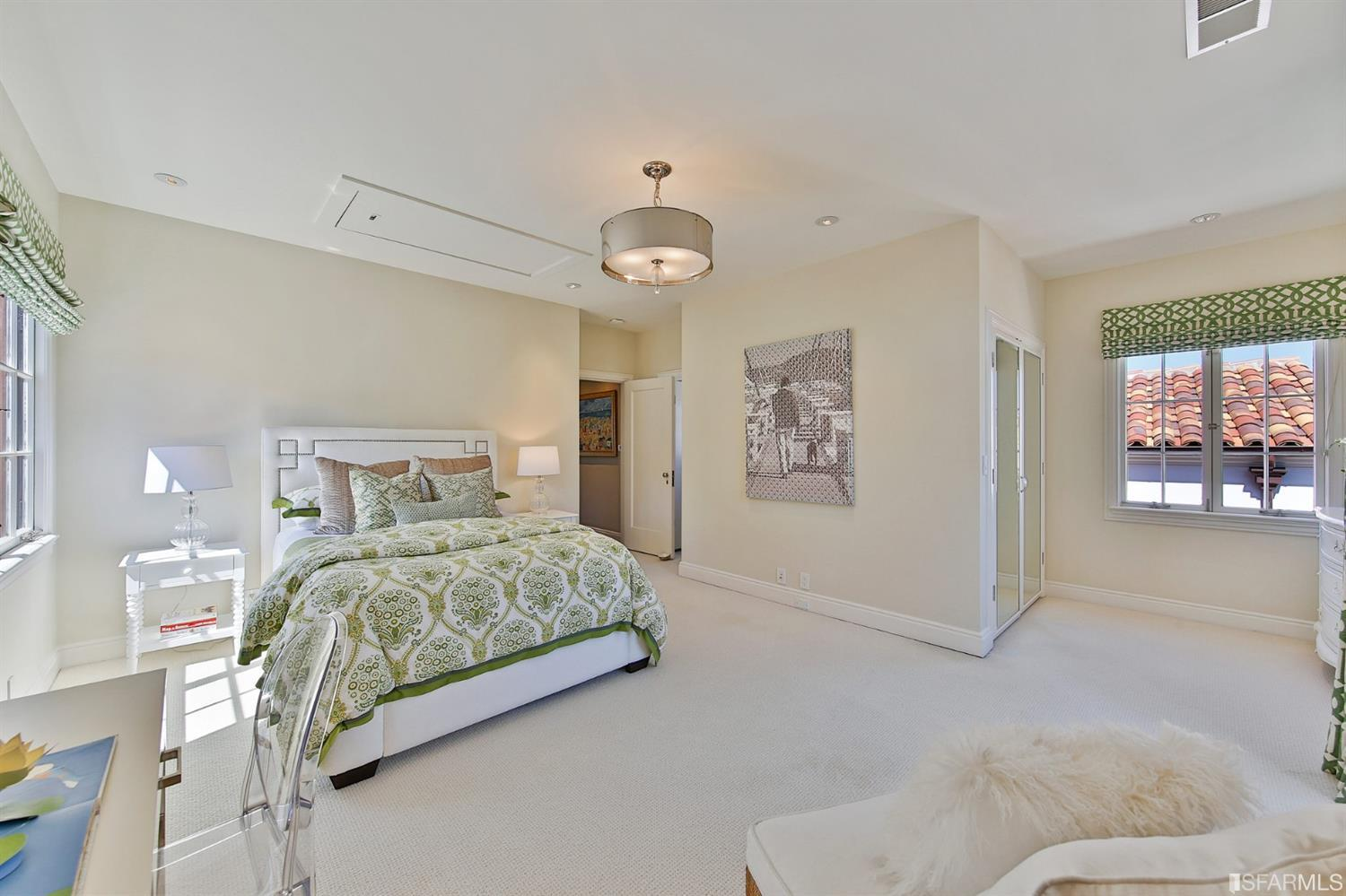 Bedroom 2 also spacious in size has en suite bath, juliette balcony and beautiful views of the neighborhood.