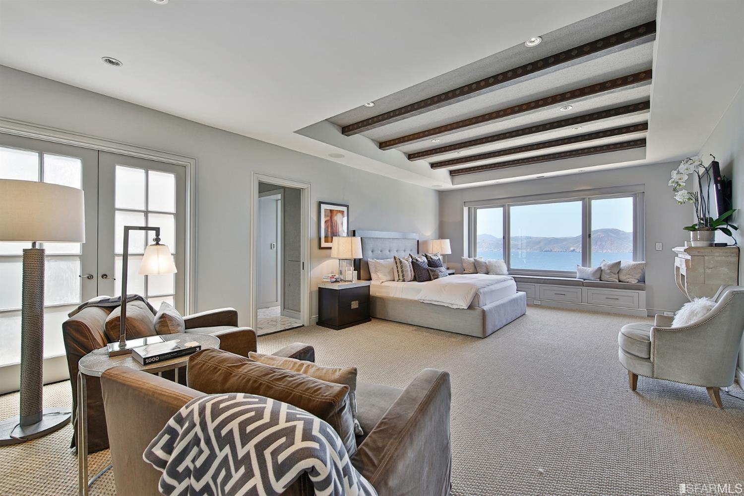 Huge master bedroom with sweeping views, gas fireplace, en-suite bath, walk-in closet and home office.